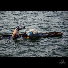 Fisherman (vinothyadav) Tags: ocean sea man beach water boat big fishing fisherman indianocean fisher chennai tamilnadu inida oldboat seawater morining woodboat d7000 oldfishing manonoldfishingboat