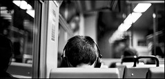 head in phones (matteoprez) Tags: people bw white black film analog train 50mm gente olympus iso plus asa matteo bianco treno ilford fp4 zuiko nero 114 125 om2n prezioso bnpersone matteoprezioso bnviaggio
