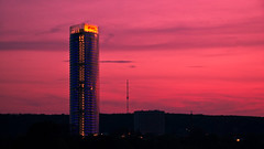 Posttower sunset kitsch (manganite) Tags: bridge light sunset red sky topf25 colors clouds digital buildings germany dark geotagged dawn evening nikon colorful europe bonn purple tl silhouettes onecolor d200 nikkor dslr rheinaue posttower northrhinewestphalia thecolorred 18200mmf3556 utatafeature manganite nikonstunninggallery konradadenauerbrcke repost1 date:year=2008 geo:lat=50718757 geo:lon=714416 date:month=may date:day=3 format:ratio=169 stadtgetty2010