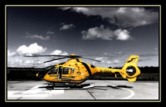 Helimed 2 on the pad at Dalcross (prajpix) Tags: yellow photoshop scotland highlands manipulation ambulance helicopter sas emergency inverness hems eurocopter ec135 supershot helimed dalcross anawesomeshot parrafinbudgie nseriesphotoclub