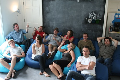 Photo of the Carsonified Team sitting in front of the blackboard