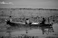 Tom Sawyer II (Quinn Ryan Mattingly) Tags: life people white lake black boys water tom living boat asia cambodia with near siem reap sawyer sap lar
