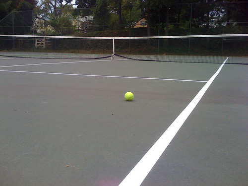 Tennis ball on an empty tennis court - Taken With An iPhone