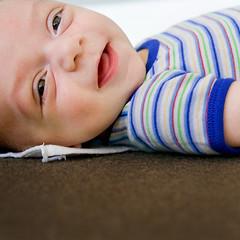 he thought my monkey noises were pretty funny. (sesame ellis) Tags: boy baby nikon infant son d3 mykid3 racheldevine wwwracheldevinecom kyear1 editedwithsethefirststoplightroompresets