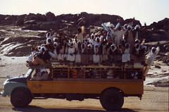 Transport in Niger. (cookiesound) Tags: life africa trip travel vacation people holiday man bus men travelling sahara smile niger truck canon photography hands reisen driving fotografie urlaub afrika canoneos poeple reise agadez travelphotography traveldiary heavyload travelphotos reisefotografie airmountains loadedtruck travelshots reisefotos reisetagebuch reisebericht travellifestyle cookiesound nisamaier ulrikemaier fullyloadedtruck poepleontruck manypeopleontruck truckinniger truckinafrica