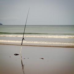 on auto (eyebex) Tags: sea newzealand reflection beach delete10 square fishing sand horizon lastday save2 calm rod northisland 210 uretiti