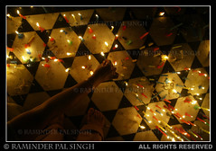 Lights of Devotion (Raminder Pal Singh) Tags: light woman india asia candles pattern floor arm time faith religion culture belief celebration 1d observe sikhs sikh punjab custom devotee amritsar thegoldentemple canon1d darbarsahib sachkhand harimandarsahib flickrsbest earthasia bandichorhdiwas flickrlovers devoteelightingcandles devoteeatthegoldentemple sikhdevotee