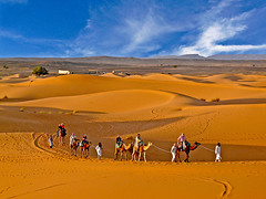 Moving Sands (Explore(d) (Rosita So Image) Tags: travel orange clouds landscape skies desert dune peoples explore morocco caravan sands erg chebbi movingsands naturescreations