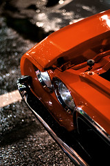 Headlight Highlights (Sikario) Tags: orange 20d rain canon 50mm florida bokeh contax dodge oldtown kissimmee challenger planar f17 dodgechallenger bokehlicious