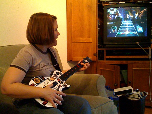 Cathy playing Guitar Hero for the first time