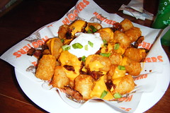 Tater Tots with cheese, bacon, sour cream & chives (BuccaneerBoy) Tags: girls food hot beautiful cheese bacon yummy pretty florida gorgeous hooters babe september babes hotbabes tatertots chives lakeland prettygirls sourcream hootergirls hootersofinternet