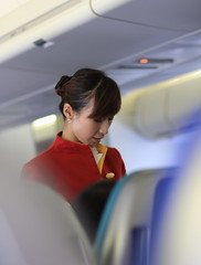 On board Cathay Pacific (A Sutanto) Tags: red woman cute girl asian cabin uniform bokeh young cx staff airline inside airlines stewardess fa b747 flightattendant cathaypacific b744