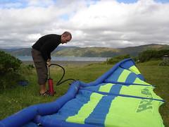 Pumping up an old sea kite near Wellington, New Zealand