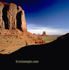 Monument Valley Journey (StevensonPhotography.com) Tags: pictures trip travel vacation arizona monument beautiful bicycle silhouette rock stone landscape lost outdoors photography climb photo pix photographer stuck image photos pics outdoor hill scenic dramatic visit cliffs adventure journey valley bicyclist hillside monumentvalley backroads uphill slope professionalphotographer bikerider outoftheway arizonahighways stevensonphotography