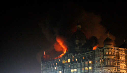 A fire breaks out of the dome of the Taj hotel in Mumbai