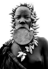 Beauty in Mursi tribe Ethiopia (Eric Lafforgue) Tags: africa woman shells girl artistic dam african plate tribal ornament clay lip bodypainting ethiopia tribe ethnic rite barrage mursi bodymodification tribo labret adornment pigments tribu omo eastafrica thiopien etiopia ethiopie etiopa tribalgirl lafforgue  etiopija ethnie ethiopi  lipplug lipplate 3760 etiopien etipia  etiyopya  southethiopia nomadicpeople   tribalgirls    salinicostruttori    plateaulabial gibeiiidam gibe3dam bienvenuedansmatribu peoplesoftheomovalley lipdisclipplate piercedhole piercedlipornament
