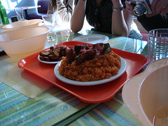 Mixed meats jollof rice with fried plantains