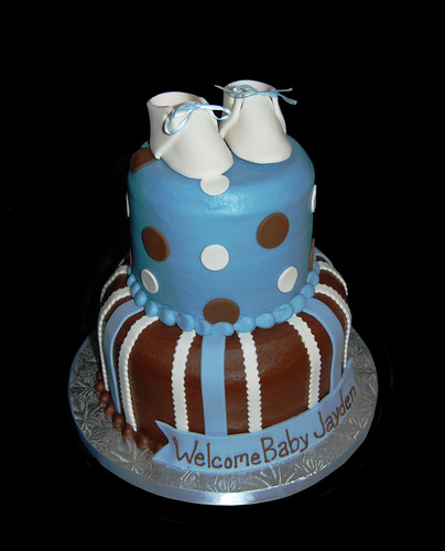 blue and brown 2 tier baby shower cake with booties