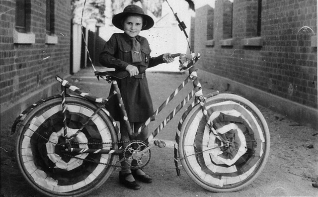 Brownie (Muriel Long) with bicycle decorated for street procession - Deniliquin, NSW, n.d.