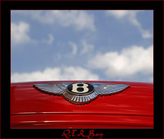 .. Bentley in Red .. (Q.T.R_B.o.y  M.A.D.R.I.D.I ) Tags: blue b red sky beauty car clouds wings ride fav luxury bentley qatar bently platinumphoto diamondclassphotographer flickrdiamond qtrboy hawaalrayyanfav
