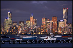 Melbourne from Williamstown (Luke Tscharke) Tags: sea sky water beautiful skyline architecture night canon geotagged boats eos lights pier interestingness interesting twilight cityscape view dusk australia melbourne victoria explore telephoto williamstown cbd 2008 rialto eureka tyre xsi portphillipbay hobsons explored melbourneskyline whitetyres melbswest 450d auselite digitalrebelxsi efs55250mmf456is geo:lat=37858837 geo:lon=144902378 lushaki luketscharke copyrightluketscharke