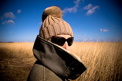 pompom in the wind (flamed) Tags: blue sky cold hat sunglasses copenhagen denmark warm windy jacket covered danish fields empy pompom expanse incognito denmarkcopenhagen