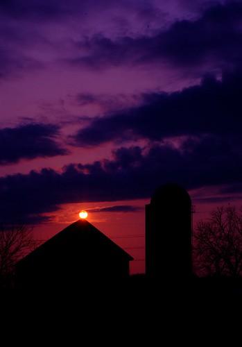 Sun Setting on Farm House