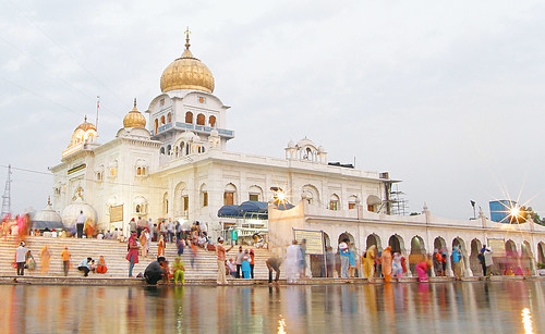 Sikhs bathe in the holy water of the Temple in Delhi