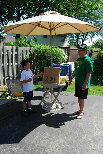my nephew and his dad man the lemonade stand