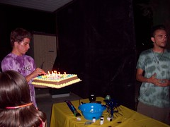 little bro bringing his big bro the cake (legogrrl4) Tags: birthday family party music cake 60s candles chocolate graduation tie dye sixties