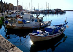 Venetian Harbor in Chania on the Greek island of Crete (Peace Correspondent) Tags: reflection water marina d50 harbor pier boat wooden dock ancient marine ships vessel fv5 creta greece crete hania venetian xania chania greekisland harborage 5photosaday views1500 seaofcrete canea venetianharbor peacecorrespondent