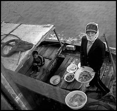halong bay (axiepics) Tags: travel boy blackandwhite bw food woman work boat asia working vietnam meal worker plates dishes job halongbay foodvendor friendlygames gameswinner friendlygameswinner copyrightalexskellyallrightsreserved