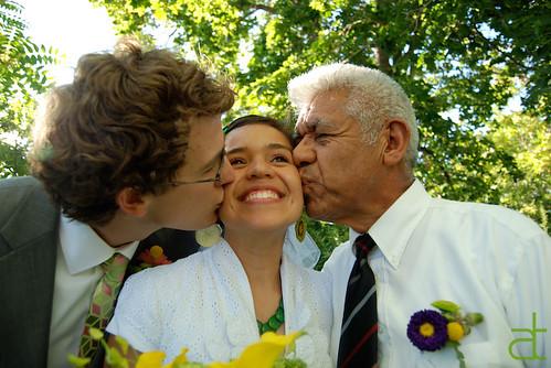 cheek kissed bride