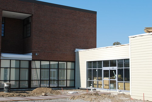 The outside of the aquatic center has siding and windows!