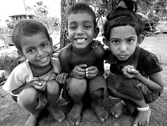 we spell trouble (LindsayStark) Tags: travel boy blackandwhite girl kids children war asia child conflict srilanka humanrights humanitarian trincomalee trinco southasia displaced idps idp humanitarianaid emergencyrelief postconflict waraffected conflictaffected
