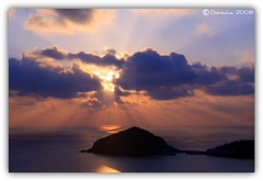 Autumn Sunset (Giorgio Di Iorio Photo - Gioischia) Tags: autumn light sunset sea sky italy sun nature sunshine clouds canon eos italia tramonto nuvole mare ray sigma natura beam cielo rays sole autunno ischia sunbeam luce dei raggi santangelo baia 2470mm golfodinapoli naturalmente maronti gulfofnaples 450d gioischia theunforgettablepictures