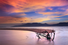 Dissipated Bliss (nathan gonzales) Tags: ocean longexposure sunset sea sky sun mountain seascape color nature water misty clouds canon dawn interesting philippines shore filipino subic sbma 30d zambales landscaped nathangonzales