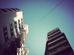 alto, cada vez más alto (®ominita) Tags: city blue sky azul architecture buildings arquitectura edificios buenosaires nikon ciudad cables cielo 2008 coolpixs7c diciembre2008