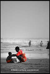 He didn't tell me how to live; he lived, and let me watch him do it (Danial Shah) Tags: pakistan sea bw color colour love beach view father care clifton bnw karchi affaction edanial muhammaddanial hedidnttellmehowtolivehelived andletmewatchhimdoit onepakistanonenation muhammaddanialshah