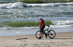 The man an the sea (AnyMotion) Tags: travel sea man beach 2004 bicycle strand reisen waves balticsea fahrrad lithuania wellen litauen curonianspit anymotion