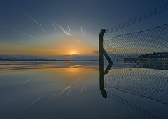 Sunrise Abuse - Contrails and Fence (wentloog) Tags: uk morning sea sky sun seascape reflection water southwales wa