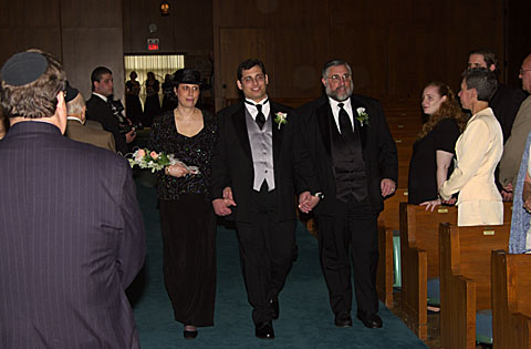 09 JL and parents walking down aisle