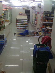 Snoozing at the Convenience Store (Augapfel) Tags: china sleeping store shanghai conveniencestore shopkeeper