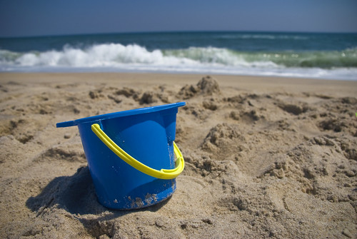 pail in sand by Alida's Photos