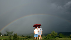 Are they my pot of gold? (btish2003) Tags: light boy sun mountains nature girl beauty weather kids umbrella rainbow pretty child grant under upstateny hills bow imagination glowing rays sunrays beams mothernature nys adirondackmountains rainshowers trishgrant trishgrantphotography btish2003 trishleise
