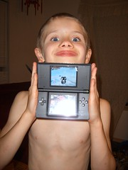 Dakota's favorite game (whispers of silence) Tags: boy game happy video transformer nintendo ds off his showing