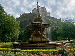 (ssj_george) Tags: park leica uk pink flowers blue red sky castle water fountain colors yellow clouds garden lumix scotland edinburgh colours purple vivid panasonic hidden tz3 goldstaraward