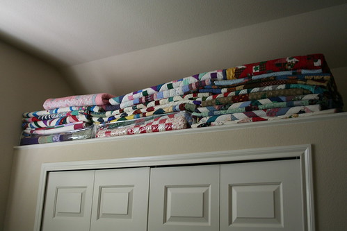 A few more quilts just hanging out on a shelf