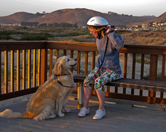 Dawn Beattie and Dog Kendall (mikebaird) Tags: sunset goldenretriever bench dawn helmet perro rails morrobay mansbestfriend overlook kendall cloisters loyalty beattie bikehelmet companionship bestbuddy womansbestfriend dawnbeattie slitsoflight