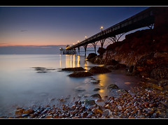 Pier n' Pebbles. (Roger.C) Tags: longexposure sea seascape reflection water beauty night canon dark lights pier sigma somerset clevedon